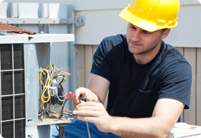 young-tradesmen-working-on-air-conditioner